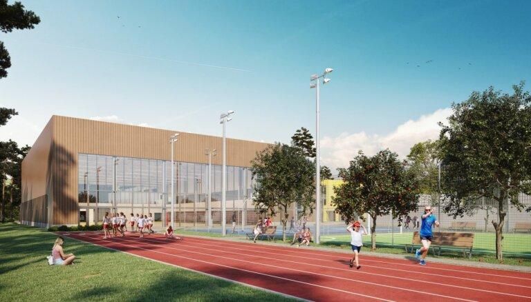 Foto: Jūrmalā ieliek pamatakmeni jaunai sporta zālei