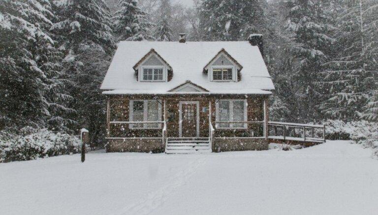 Foto: Dzīvojamie nami izrotāti kā piparkūku mājiņas