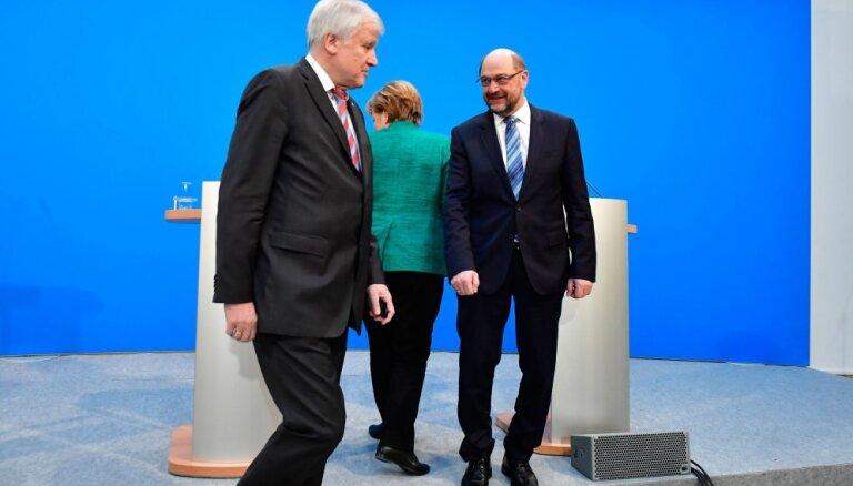 Merkeli par piekāpšanos koalīcijas sarunās kritizē pat savējie