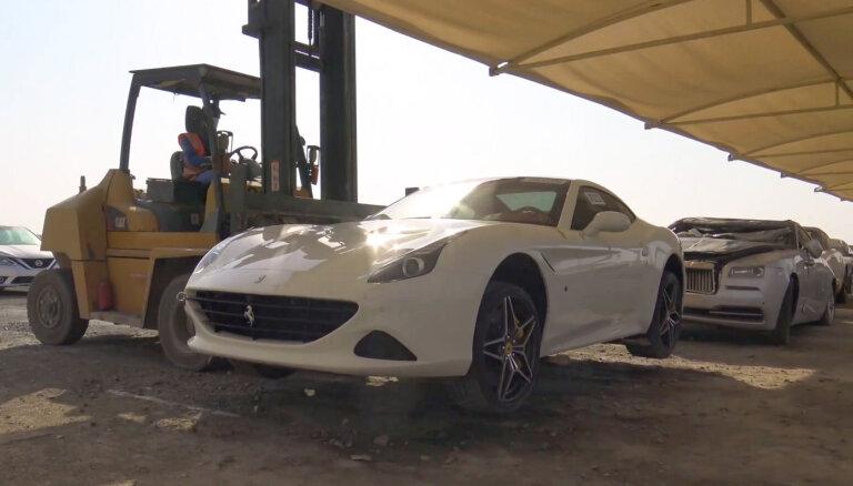 ФОТО, ВИДЕО: На кладбище машин в Дубае можно купить даже новые суперкары. Недорого