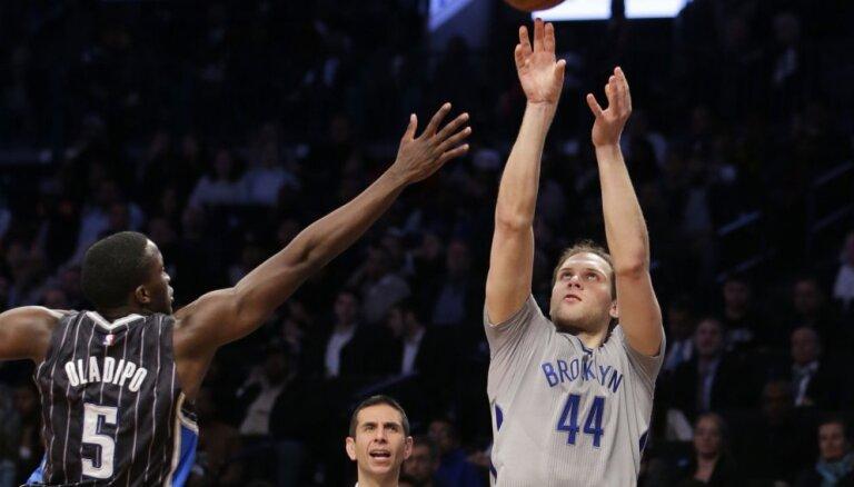 Клуб Прохорова завоевал последнюю путевку в плей-офф НБА