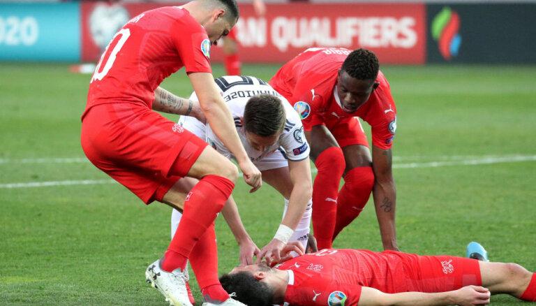 Грузинский футболист Ананидзе спас жизнь швейцарцу во время отборочного матча