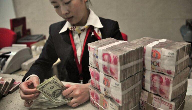 ASV dolāru uz leju nospiež Ķīnas juaņa devalvācija